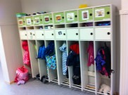Row of kids lockers filled with even more layers of clothing