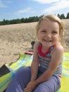 smiley girl LOVES the beach!